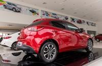 Cần bán Mazda 2 New All đời 2015, màu đỏ, giá tốt tặng bảo hiểm thân vỏ 1 năm giá 609 triệu tại Hà Nội