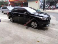 Cần bán gấp Toyota Vios 1.5 E đời 2014, màu đen số sàn, giá tốt