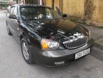 Cần bán xe Daewoo Magnus đời 2004, màu đen, giá 225 triệu