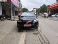Bán ô tô Toyota Vios E đời 2014, màu đen số sàn, giá 550tr