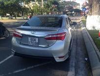 Cần bán Toyota Corolla đời 2014, màu bạc, nhập khẩu chính hãng, xe gia đình