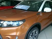 Xe  Suzuki Vitara màu cam nóc trắng - giảm 20 triệu - lấy xe ngay