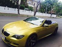 Cần bán xe BMW M6 V10 đời 2008, màu vàng, nhập khẩu, đã đi 57000 km