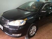 Cần bán Toyota Corolla altis 1.8G đời 2005, màu đen, nhập khẩu nguyên chiếc xe gia đình