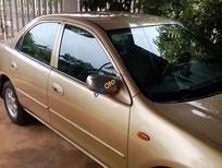 Cần bán xe Mazda 323F năm 1999, màu vàng, 170tr