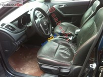 Cần bán lại xe Kia Forte AT đời 2011, màu đen