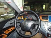 Bán ô tô Mitsubishi Lancer GLX đời 2003, màu bạc