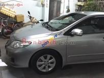 Cần bán Toyota Corolla altis G đời 2009, màu bạc số sàn
