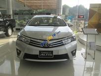 Cần bán Toyota Corolla Altis 1.8 MT 2016, màu bạc, hỗ trợ vay lên đến 85%, có xe giao ngay