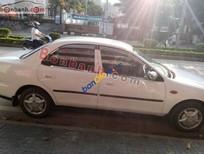 Cần bán lại xe cũ Mazda 323 đời 2000, màu trắng