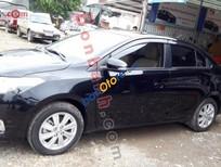 Bán xe cũ Toyota Vios 1.5E đời 2014, màu đen số sàn
