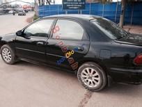 Cần bán gấp Mazda 323 đời 2000, màu đen
