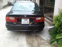 Bán Mazda 323 sản xuất 1999, màu đen giá cạnh tranh