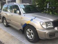 Bán ô tô Toyota Land Cruiser đời 2002, màu vàng
