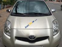 Cần bán Toyota Yaris 1.3AT đời 2009, màu vàng, xe nhập