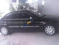 Cần bán xe cũ Ford Mondeo 2.5AT đời 2004, màu đen, 285 triệu