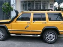 Cần bán Jeep Cherokee sản xuất 1998, màu vàng, xe nhập giá cạnh tranh