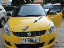 Cần bán Suzuki Swift AT đời 2015, màu vàng, 550tr