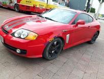 Cần bán xe Hyundai Tuscani đời 2003, màu đỏ