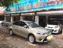 Cần bán lại xe Toyota Vios G 1.5AT 2014, màu vàng số tự động