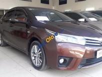 Cần bán lại xe Toyota Corolla altis 1.8G đời 2015, màu nâu vàng, xe gia đình