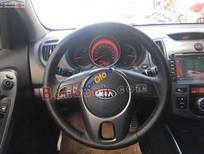 Bán xe cũ Kia Cerato 1.6 AT 2010, màu đen, nhập khẩu