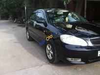 Cần bán Toyota Corolla đời 2004, màu đen