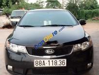 Cần bán gấp Kia Cerato AT đời 2010, màu đen số tự động