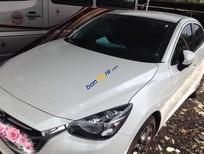 Cần bán lại xe Mazda 2 sản xuất 2016, màu trắng đẹp như mới, 555 triệu