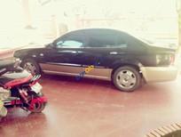 Cần bán lại xe Daewoo Magnus sản xuất 2004, màu đen