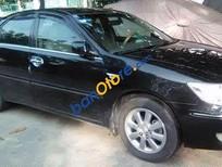 Cần bán Toyota Camry 3.0 đời 2003, màu đen số tự động