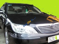 Cần bán lại xe Toyota Camry 3.0AT đời 2003, màu đen xe gia đình, giá tốt