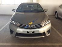 Bán xe Toyota Corolla Altis 1.8 MT đời 2016, màu bạc