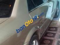 Bán xe Ford Laser đời 2002, màu vàng
