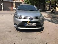 Cần bán xe Toyota Vios E năm 2014, màu bạc số sàn