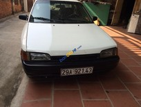 Bán ô tô Mazda 323 đời 1995, màu trắng, nhập khẩu nguyên chiếc