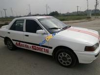 Bán Mazda 323 đời 1995, màu trắng, nhập khẩu nguyên chiếc, giá chỉ 60 triệu