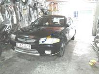 Cần bán Mazda 323 đời 1999 đăng ký lần đầu 2009