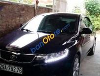 Cần bán gấp Kia Forte MT đời 2013, màu đen, xe cũ