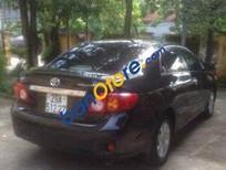 Cần bán gấp Toyota Corolla Altis AT đời 2009, màu đen