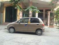 Bán xe Daewoo Matiz đời 2004, màu ghi vàng