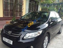 Cần bán Toyota Corolla altis MT đời 2009, màu đen số sàn
