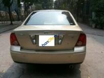 Cần bán xe cũ Ford Laser 1.8AT đời 2004, màu vàng