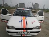Cần bán xe Mazda 323 LX đời 1995, màu trắng, xe nhập, giá 58tr