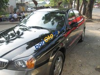 Cần bán Daewoo Magnus AT năm 2004, màu đen, 275tr