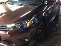 Cần bán lại xe Toyota Corolla altis 2.0V đời 2014, màu nâu