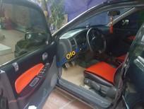 Bán Mazda 323 1998, màu đen, giá 125tr