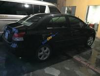 Cần bán lại xe Toyota Vios E đời 2009, màu đen