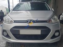 Bán xe Hyundai i10 1.2 AT 2014 màu bạc biển Sài Gòn