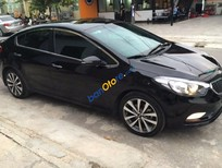 Cần bán xe cũ Kia K3 1.6AT đời 2014, màu đen